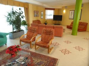 The lobby or reception area at Hotel Rey Arturo