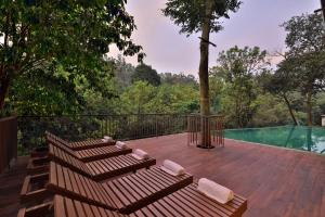 The swimming pool at or close to Abad Brookside Wayanad