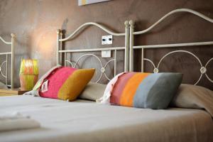 Letto o letti in una camera di Gran Can Hotel Ristorante