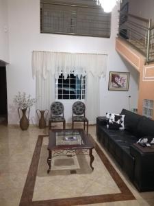 A seating area at Aconchego da paz