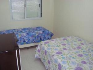 Cama o camas de una habitación en Apartamento em Praia dos Ingleses
