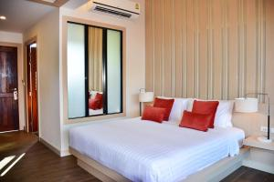 A bed or beds in a room at Lanta Sand Resort & Spa