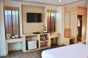 A television and/or entertainment center at Lanta Sand Resort & Spa