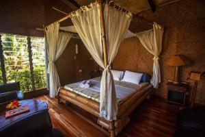 A bed or beds in a room at Maravu Taveuni Lodge