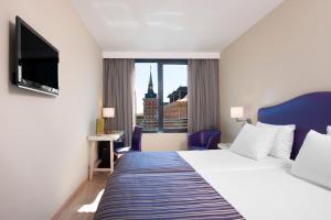 Cama o camas de una habitación en Exe Moncloa