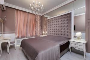 Кровать или кровати в номере Royal Arcadia Apartment