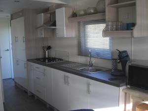 A kitchen or kitchenette at Chalet Barends