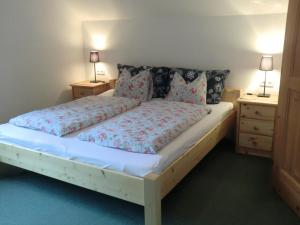 A bed or beds in a room at Haus Rye