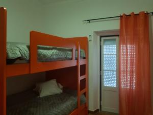 A bunk bed or bunk beds in a room at Family Home