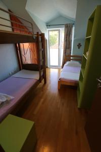 Кровать или кровати в номере Apartment Beach