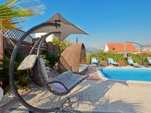 The swimming pool at or close to Apartments Silva