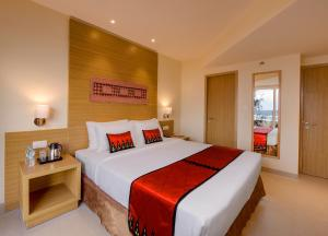 A bed or beds in a room at Sterling Puri