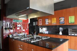 A kitchen or kitchenette at Lisb'on Hostel