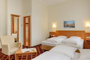 Ein Bett oder Betten in einem Zimmer der Unterkunft Mercure Hotel Luebeck City Center