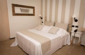 Letto o letti in una camera di Hotel Borgo Pantano