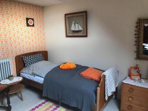 En eller flere senge i et værelse på Løkken Farm Holiday