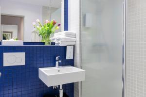 Ein Badezimmer in der Unterkunft Tulip Inn Antwerpen