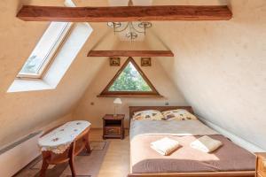 A bed or beds in a room at Apartament Czarny Potok Zakopane