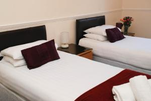 A bed or beds in a room at Birnam Hotel