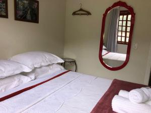 A bed or beds in a room at Hospedaria Aconchego