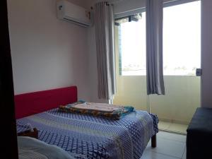 A bed or beds in a room at Cobertura Luxo com duas suítes Vista Mar Praia dos Milionários