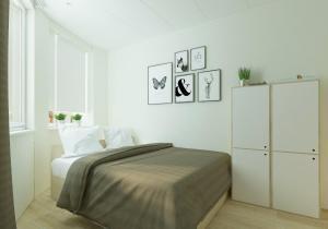 Кровать или кровати в номере Хостел Волга в Коньково
