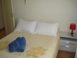 A bed or beds in a room at ARENA GREMIO.SUÍTE +2 D. ESTAC.WI-FI. AR.COND. TV.CABO