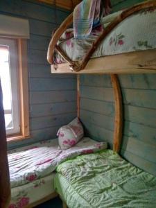 """Кровать или кровати в номере хостел """"Трутень"""""""
