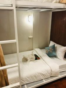 A bed or beds in a room at Sanga Hostel