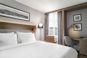Un ou plusieurs lits dans un hébergement de l'établissement Radisson Blu Hotel Bodø