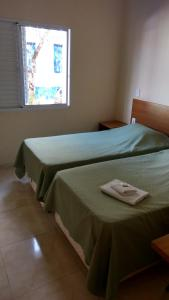 A bed or beds in a room at Hotel Paulista