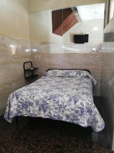 A bed or beds in a room at Hostal Río ibare