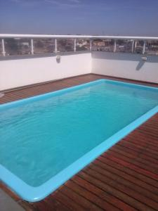 The swimming pool at or near Jaguary Hotel Sumaré