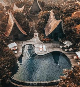 Вид на бассейн в Own Villa Bali или окрестностях