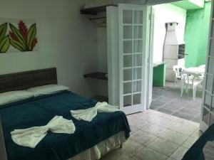 Cama ou camas em um quarto em Marencanto Pousada
