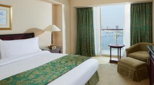 A bed or beds in a room at Grand Nile Tower