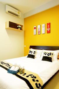 Ein Bett oder Betten in einem Zimmer der Unterkunft Smile Inn