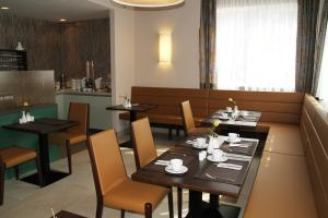 Ein Restaurant oder anderes Speiselokal in der Unterkunft Hotel Ganslhof