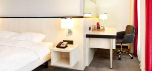 Een TV en/of entertainmentcenter bij Hotel Park Inn by Radisson Brussels Midi