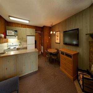 A kitchen or kitchenette at Douglas Fir Resort & Chalets