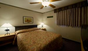 A bed or beds in a room at Douglas Fir Resort & Chalets