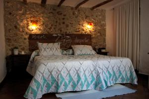 A bed or beds in a room at La Carrihuela