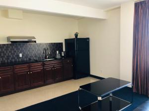 A kitchen or kitchenette at John Hotel