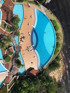 A view of the pool at Flats Tropical com Varanda or nearby