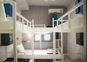 A bunk bed or bunk beds in a room at Downtown Backpackers Hostel 2
