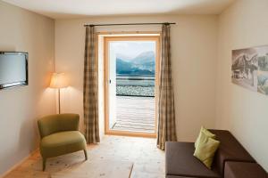 Ein Sitzbereich in der Unterkunft Romantik Hotel Muottas Muragl