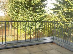 A balcony or terrace at LES JARDINS DE LA GRANGE