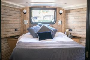 A bed or beds in a room at The Boathouse