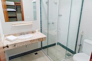 Um banheiro em Vila Real Hotel