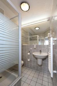 Ein Badezimmer in der Unterkunft LAT Hotel & Apartmenthaus Berlin